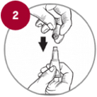 Step 2 of how to apply Advantix: Hold the applicator tube in an upright position, twist and pull off the cap